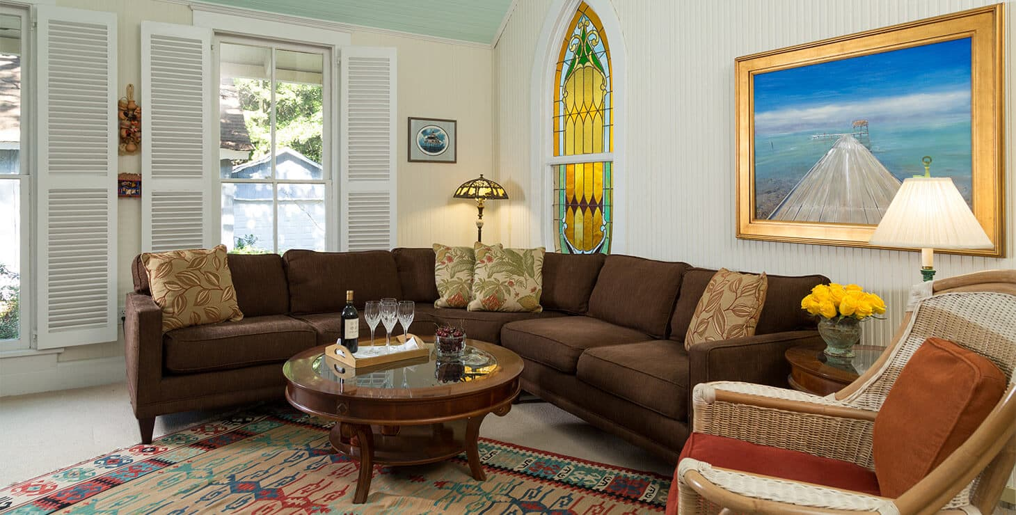 Seating room with couch and chair at our Magnolia Springs B&B