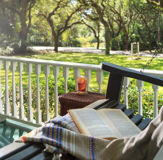 Enjoy sweet tea with a book on the porch at our Fairhope, Alabama Bed and Breakfast