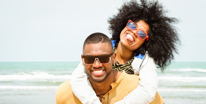 African American couple having fun at the beach