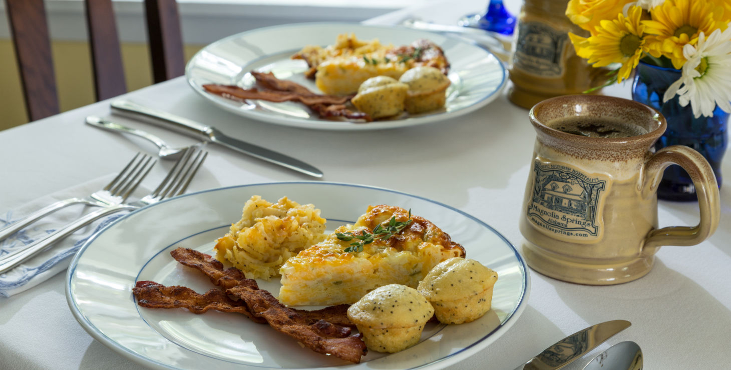 Hotel in Alabama breakfast with biscuits, eggs, bacon