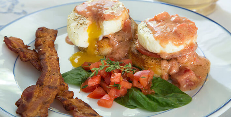 Signature Alabama Bed and Breakfast food featuring Grits and eggs benedict