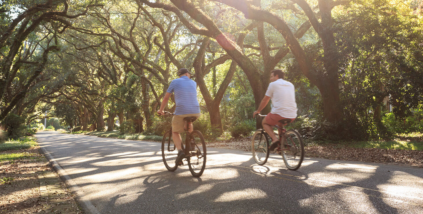 Couple biking through the trees