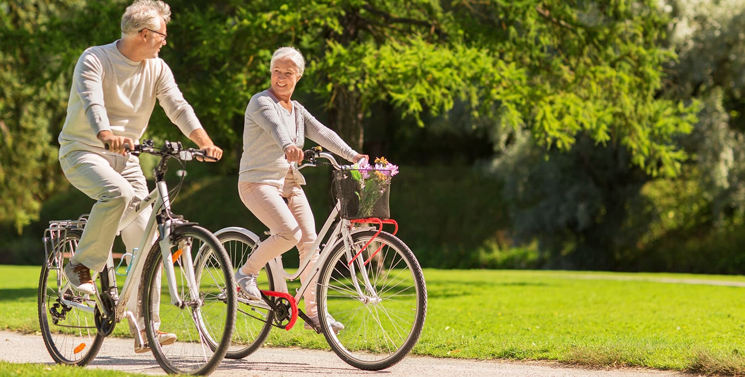 Senior couple biking in Fairhope, AL