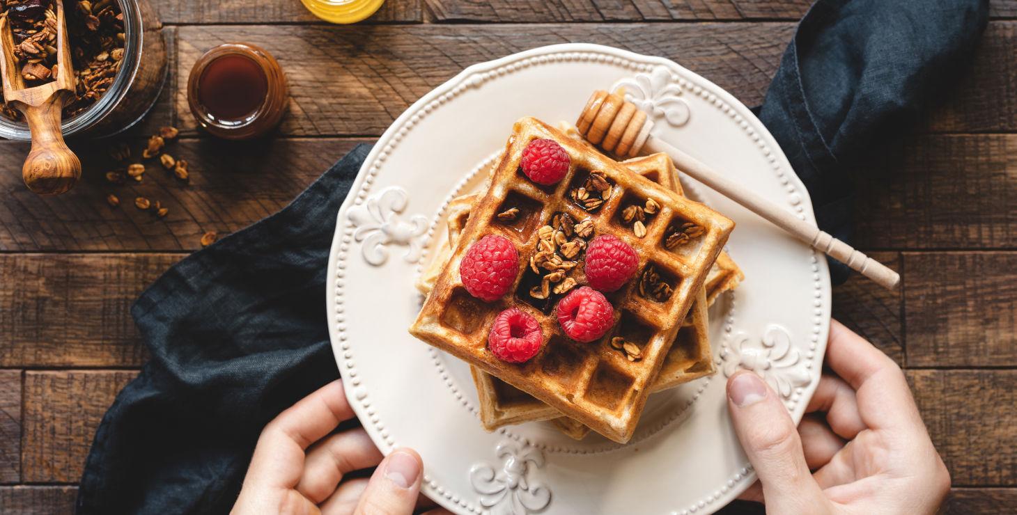Homemade Belgian Waffles with Raspberries and Honey