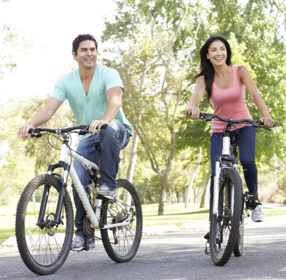 happy couple cycling together