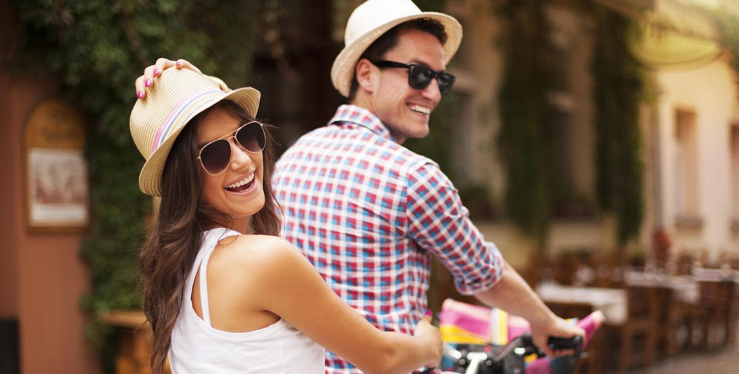 couple smiling on tandem bike